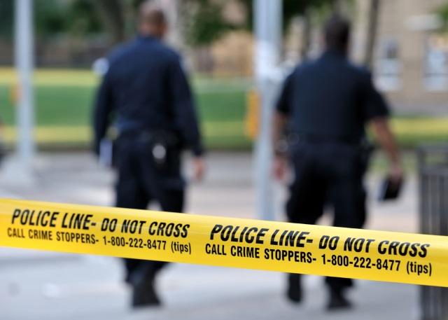 police tape shooting scene generic cops officers crime_98452