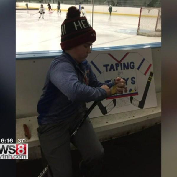 12-14-taping-hockey-sticks_368424