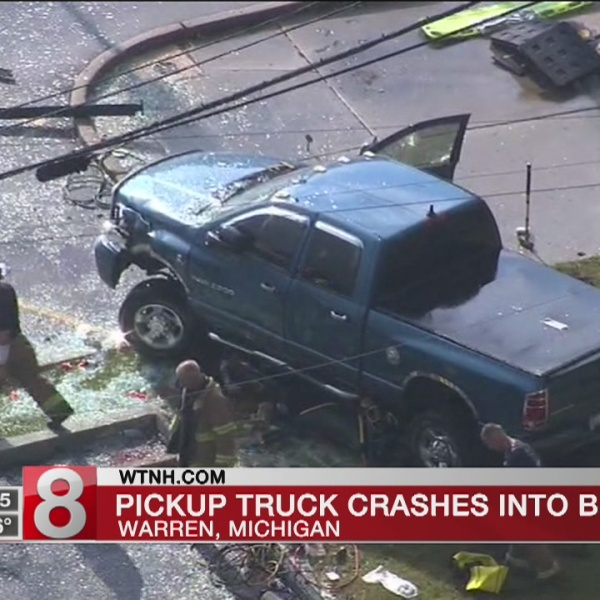 Mayor: Pickup crashes into suburban Detroit bus stop