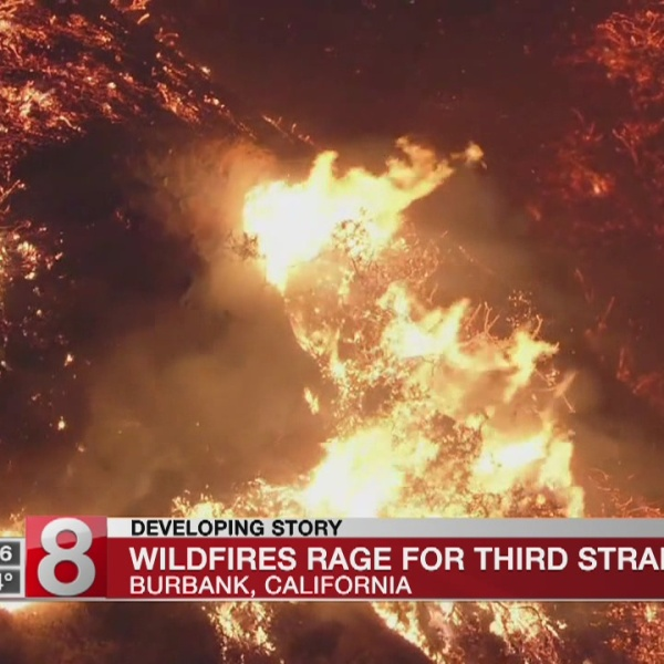 Rare heat wave bakes San Francisco; fires rage through West