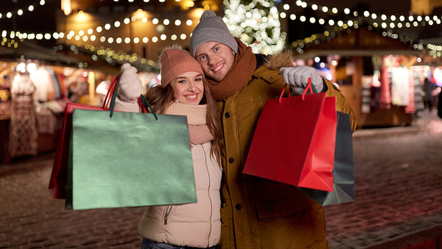 holidays, christmas and people concept - happy couple at with sh_561467