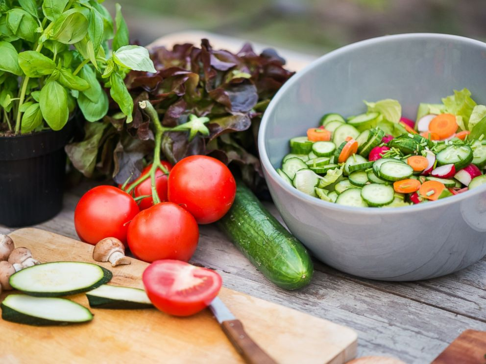 PHOTO_ Fresh vegetables are visible on a cutting board in this stock photo._5864849000533