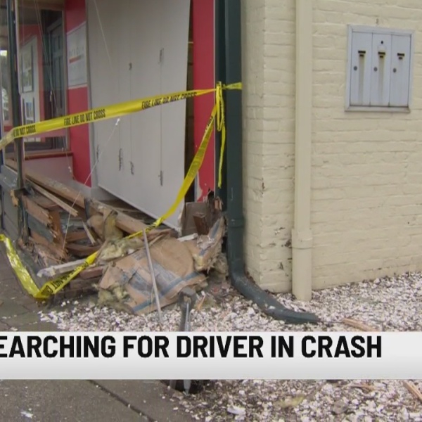 Vehicle strikes historic New Haven building, driver missing