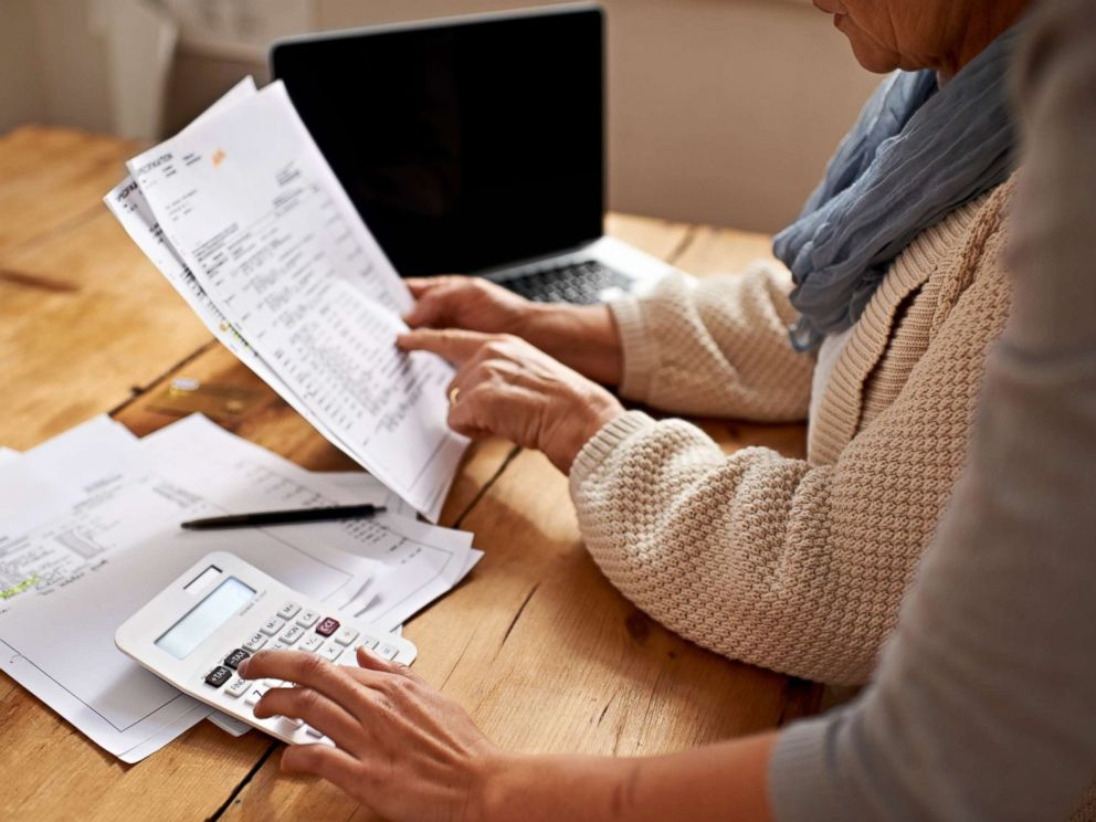 PHOTO_ A senior woman receives help with her finances in this undated stock photo._6404599000531