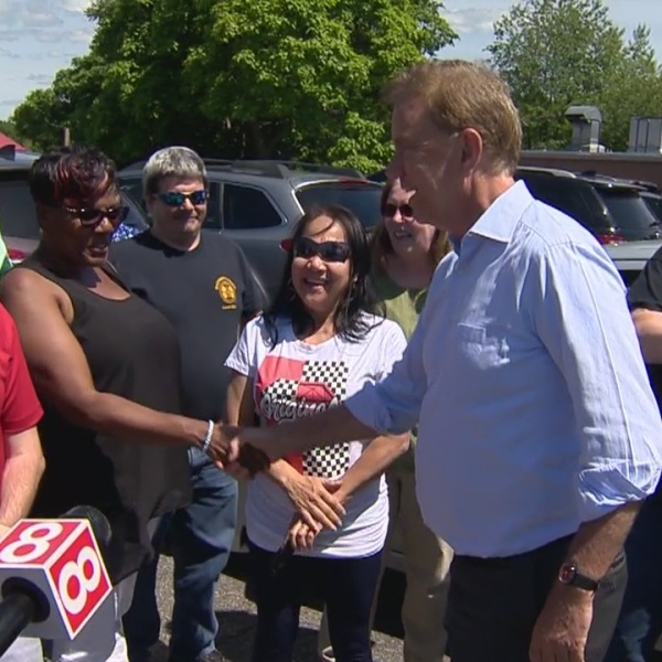 Lamont visits pre-third shift crowd near Pratt factory gate