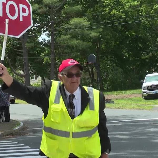 Wallingford crossing guard sends kids off to summer vacation with a wave