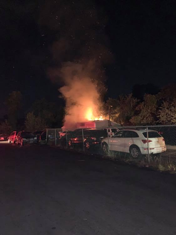 East Windsor officials respond to fire near used car lot