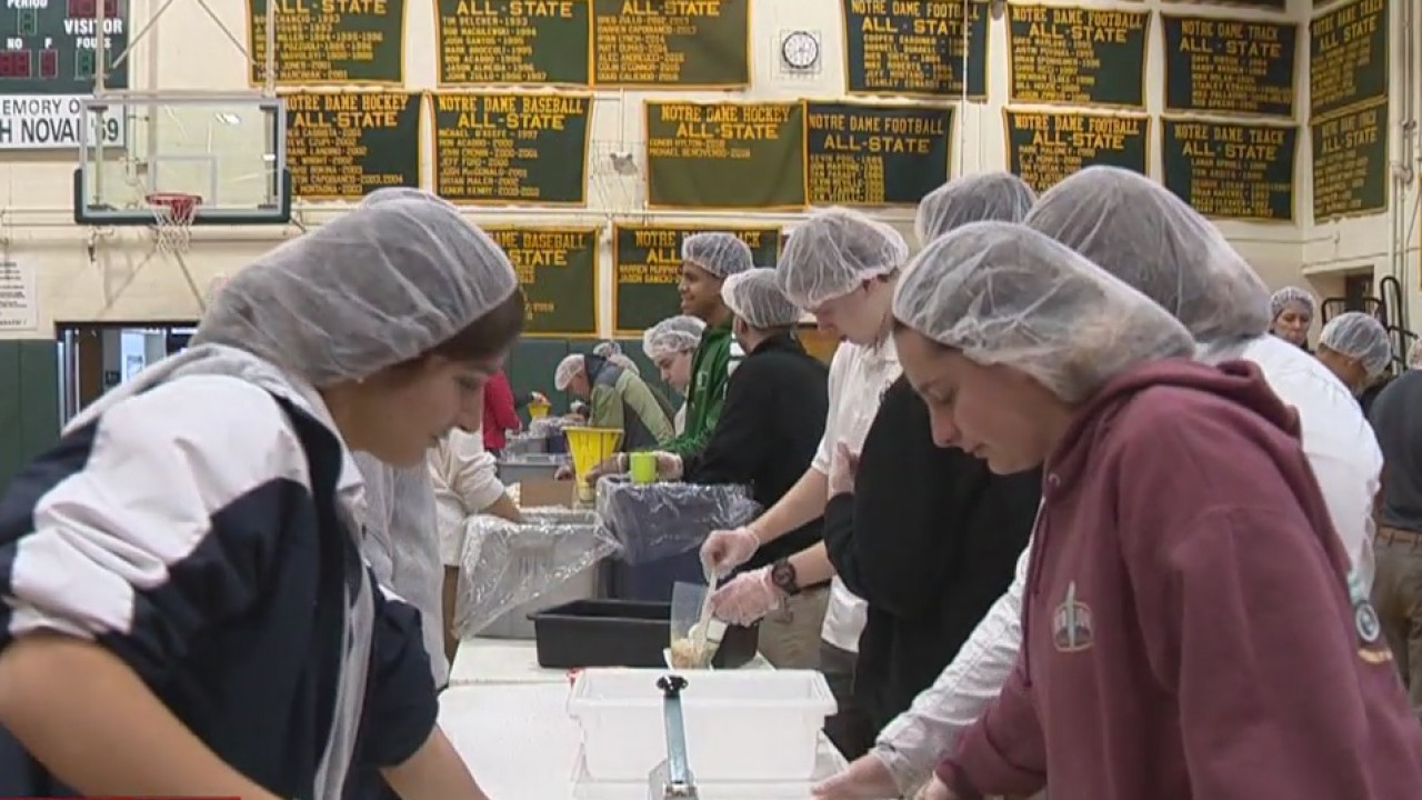 Students at Notre Dame High School pack thousands of meals for orphans in Haiti